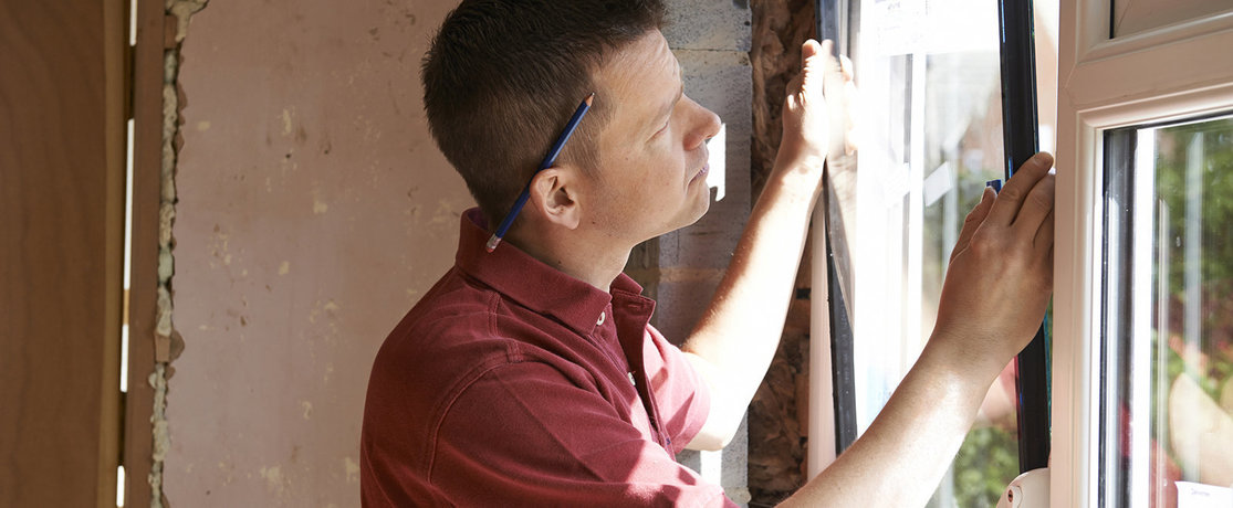 man fitting double-glazing window