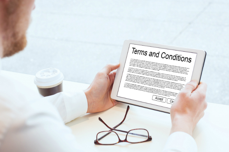 Man reading terms and conditions on a tablet