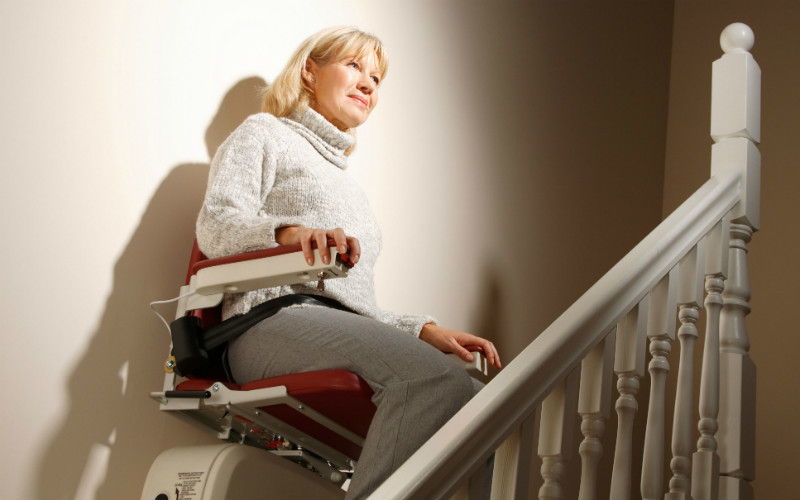 Woman using a stairlift