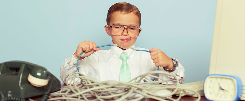 Boy looking confused holding wires