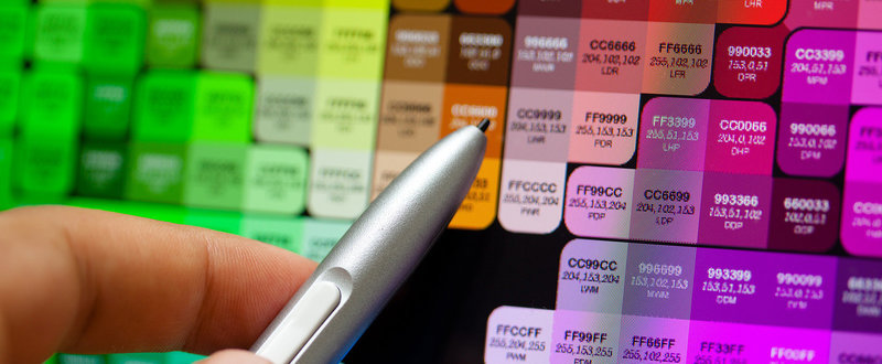 graphic web designer choosing a colour for a web page