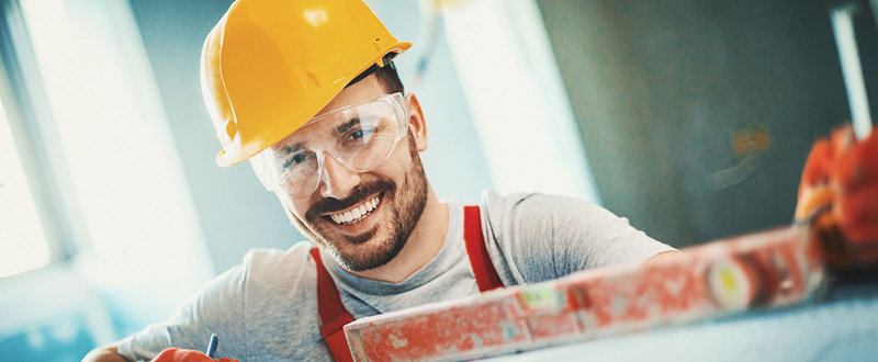 Smiling builder wearing a hard hat
