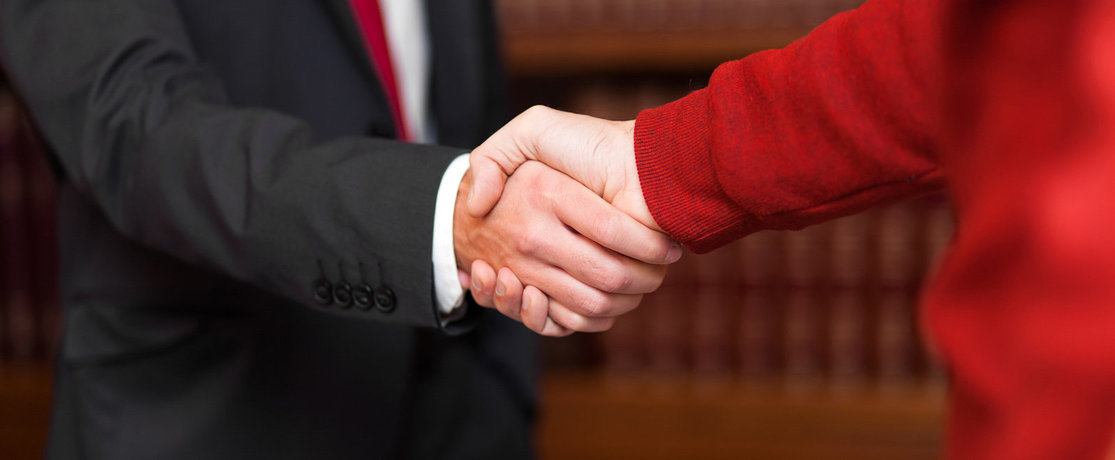 lawyer or solicitor shaking hands with client