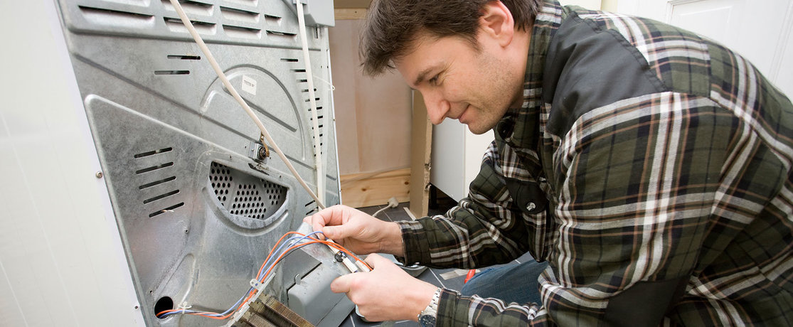 repairman fixing a washing machine