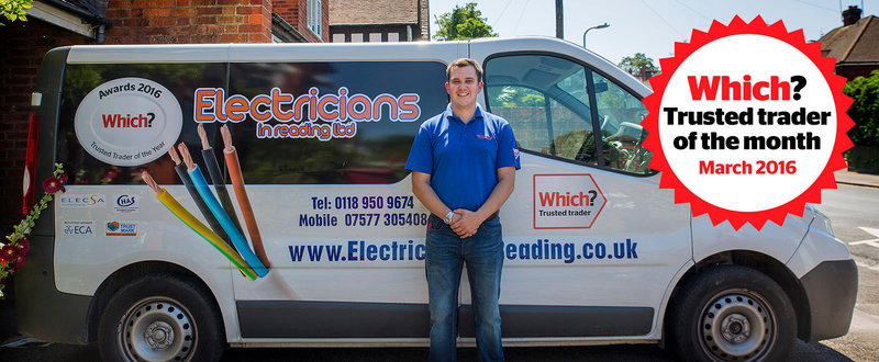 Chris Gordon, Electricians in Reading by his van and Which? Trusted trader of the month logo