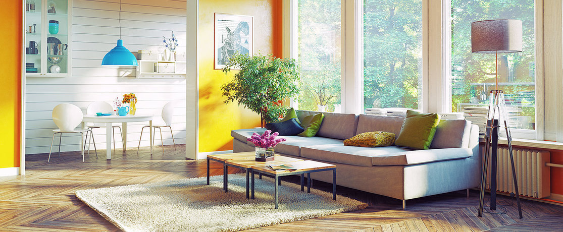 bright, cheerful, light living room, coloured cushions, light shades and wall panels