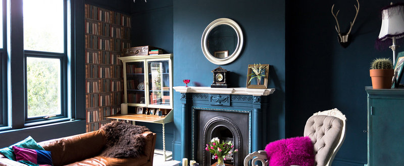 dark blue painted room with purple cushion