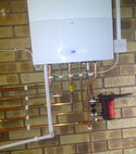 Square thumb high efficiency worcester 30si relocated in garage with inline magnaclean filter
