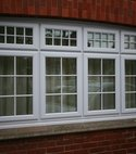 Square thumb pvcu window made to look like original