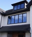 Square thumb cheam black upvc roofline 1030x772