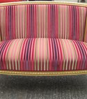 Square thumb gold leaf antique settee in a stripe fabric