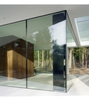 Square thumb villa one reflectioned glass walls
