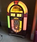 Square thumb juke box
