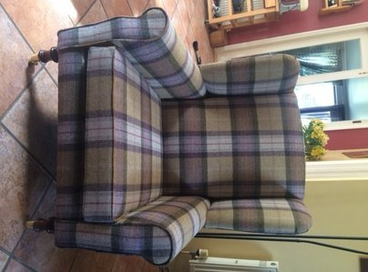 Primary thumb wing chair in a wool fabric