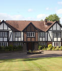 Square thumb large tudor house