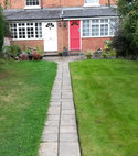Square thumb treated and untreated lawn