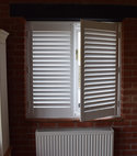Square thumb faux wood shutter