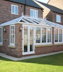 Square thumb double hip edwardian  leamington  universal windows uk  white upvc conservatory