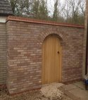 Square thumb brick wall and gate
