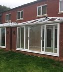 Square thumb two conservatories built together