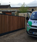 Square thumb sliding gate spud shed  steel frame timber clad 01